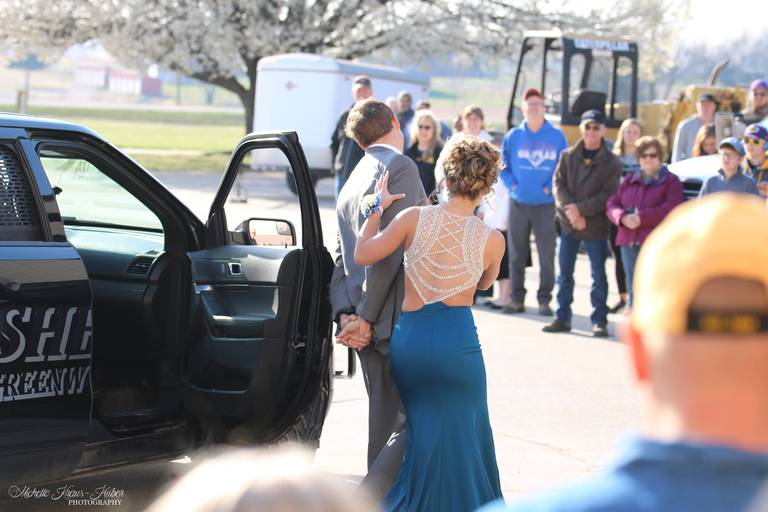 Daniel Huber and his girlfriend Alexis Berndt, rode in a sheriff's car to Madison High School